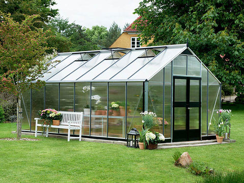 Image of Juliana Gardener Greenhouse 12ft x 19ft - 10mm Polycarbonate - front and side view - in a garden
