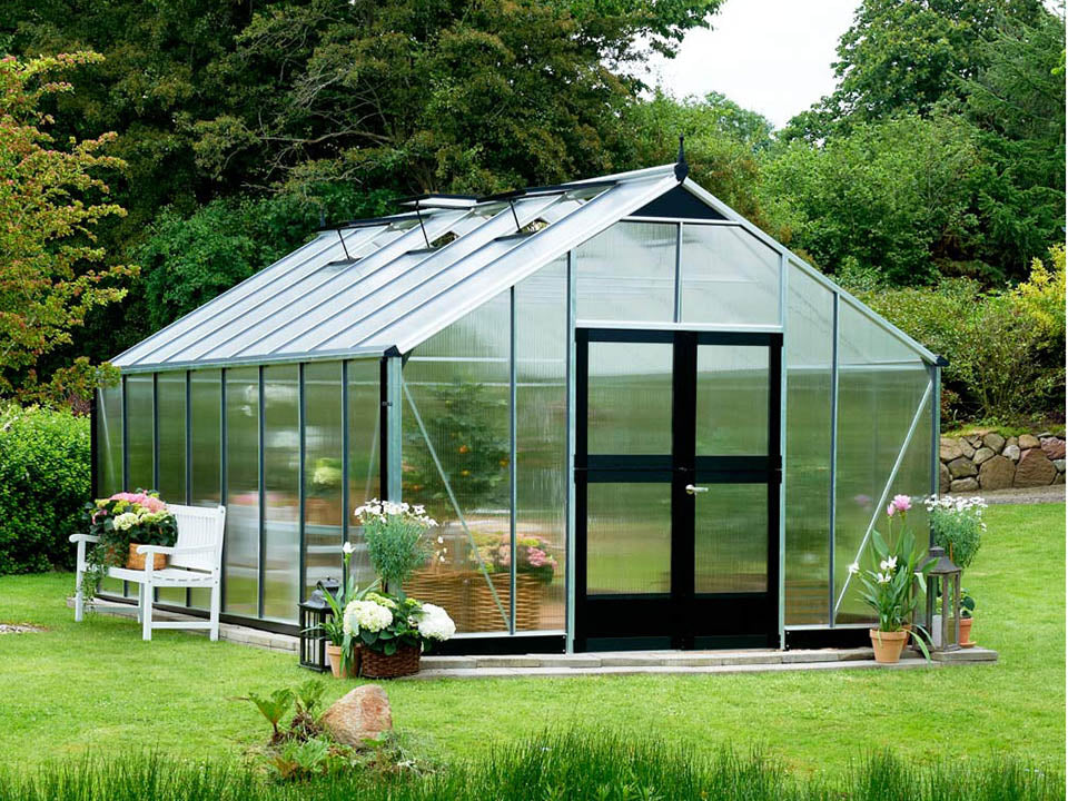Juliana Gardener Greenhouse 12ft x 19ft - 10mm Polycarbonate - front and side view - in a garden