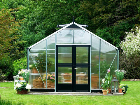 Juliana Gardener Greenhouse 12ft x 19ft - 10mm Polycarbonate - front view - in a garden