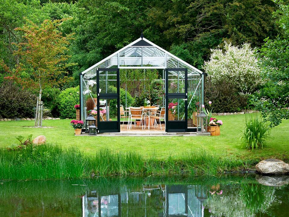 Juliana Gardener Greenhouse 12ft x 19ft - 3mm toughened glass - front view - near a river