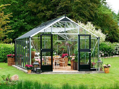 Juliana Gardener Greenhouse 12ft x 19ft - 3mm toughened glass - front view - in a garden