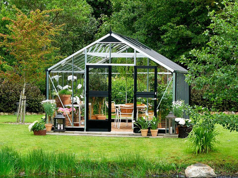 Image of Juliana Gardener Greenhouse 12ft x 19ft - 3mm toughened glass - front view - in a garden