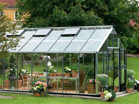 Juliana Gardener Greenhouse 12ft x 19ft - 3mm toughened glass - side view - in a garden