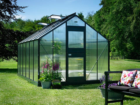 Juliana Junior Greenhouse 9ft x 14ft - Anthracite 6 mm Polycarbonate - closed door - front view - in a garden