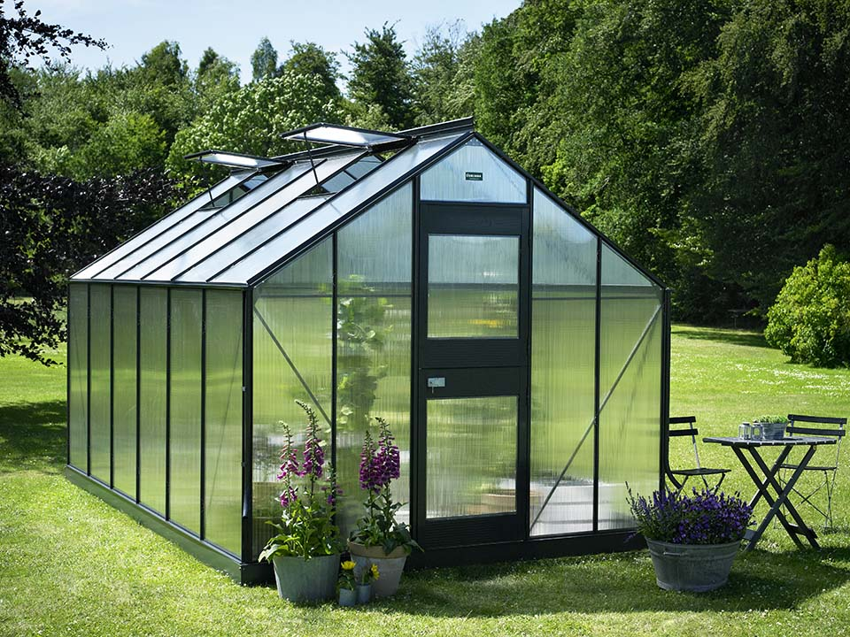 Juliana Junior Greenhouse 9ft x 14ft - Anthracite 6 mm Polycarbonate - closed door - open roof vents front view - in a garden