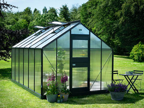 Image of Juliana Junior Greenhouse 9ft x 14ft - Anthracite 6 mm Polycarbonate - closed door - open roof vents front view - in a garden