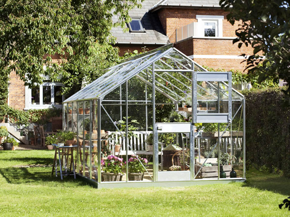 Juliana Junior Greenhouse 9ft x 14ft - Aluminum 3 mm Horticultural Glass - open door - in a garden