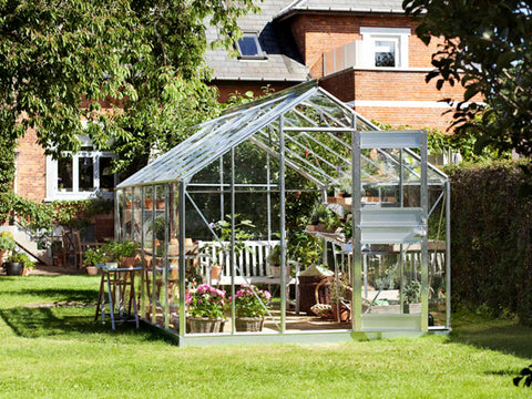 Image of Juliana Junior Greenhouse 9ft x 14ft - Aluminum 3 mm Horticultural Glass - open upper part of the door - in a garden