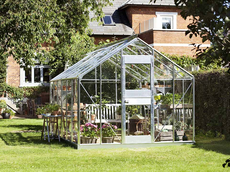 Juliana Junior Greenhouse 9ft x 14ft - Aluminum 3 mm Horticultural Glass - open double hinged door - in a garden