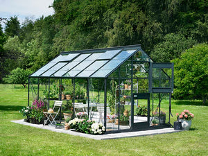 Juliana Junior Greenhouse 9ft x 14ft - Antharcite 3 mm Horticultural Glass - uuper hinged door open - in a garden