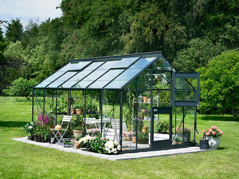 Image of Juliana Junior Greenhouse 9ft x 14ft - Antharcite 3 mm Horticultural Glass - uuper hinged door open - in a garden