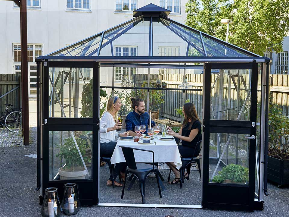 Juliana Oasis Greenhouse 10ft x 10ft Aluminum with three people inside