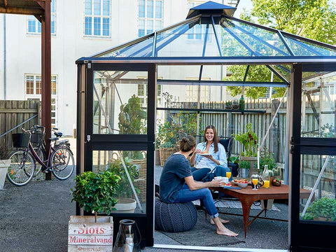 Image of Juliana Oasis Greenhouse 10ft x 10ft Aluminum with two people having meals inside