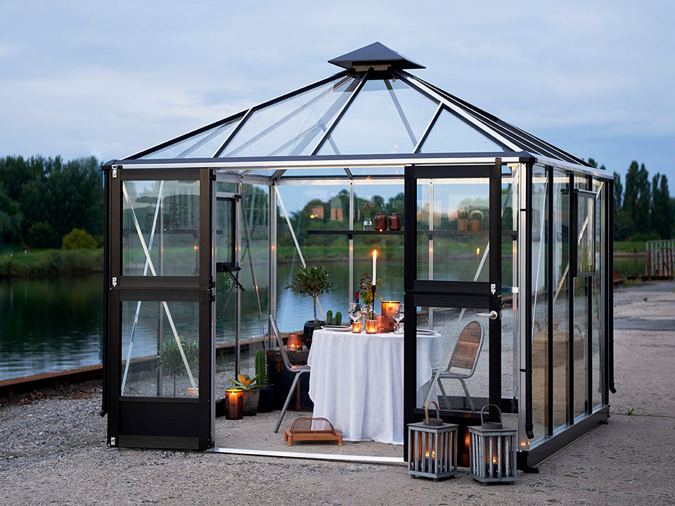 Juliana Oasis Greenhouse 10ft x 10ft Aluminum with a table for two inside
