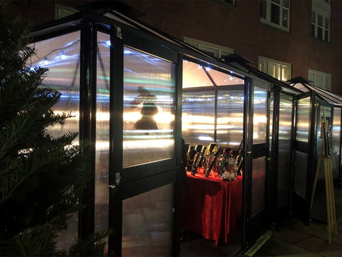 Image of A close up view of Juliana 10x10 Polycarbonate as a jewelry shop with full open doors
