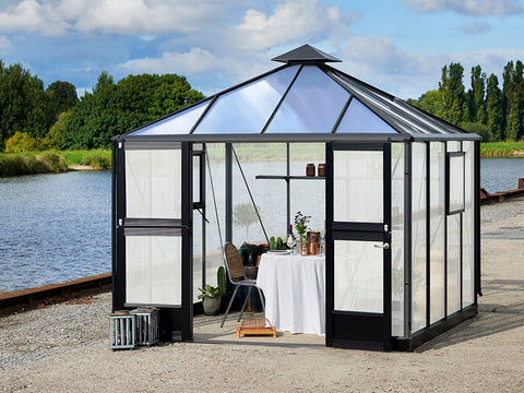 Juliana Oasis 10x10 Polycarbonate with a small dining set up inside