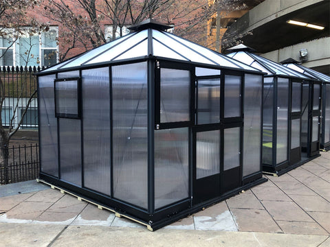 Image of Bare Juliana 10x10 Polycarbonate with open left upper door. It is showing its front and side views with closed side window
