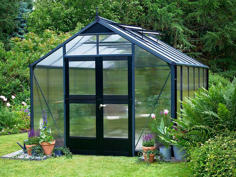 Juliana Premium Greenhouse 9ft x 14ft 10mm Polycarbonate. Closed doors with plants inside