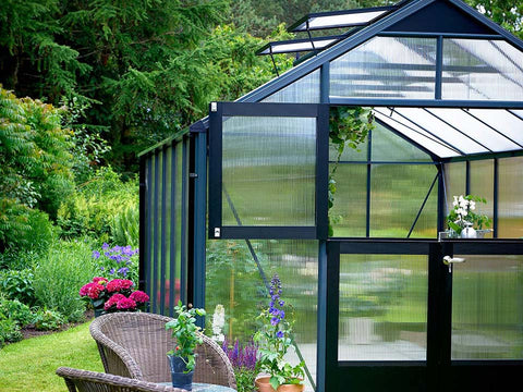 Juliana Premium Greenhouse 9ft x 14ft 10mm Polycarbonate. Upper part of the door and 2 right side roof windows are open.
