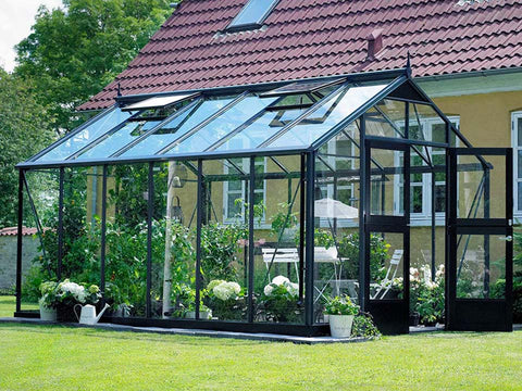 Juliana Premium Greenhouse 9ft x 14ft Anthracite 3mm safety glass with plants inside. Outdoor setting. Side and Front View. One Open Door