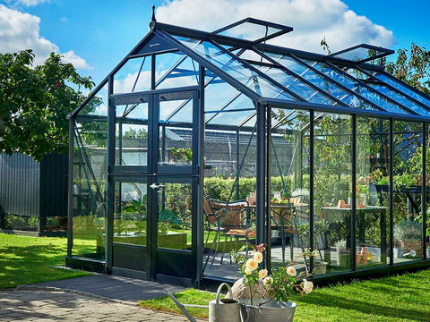 Juliana Premium Greenhouse 9ft x 14ft Anthracite 3mm safety glass. Closed doors with plants inside