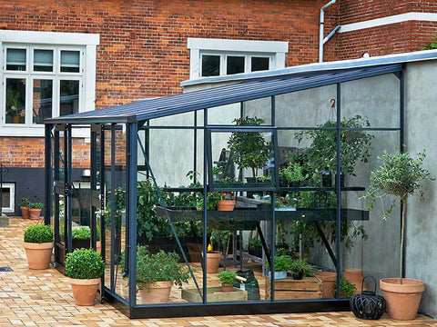 Side view Juliana Veranda Greenhouse 14ft x 10ft. Open doors