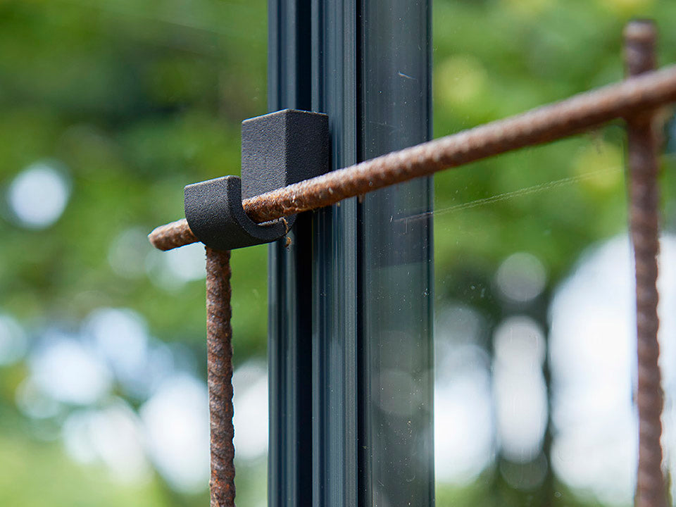 Detail view of the Juliana Greenhouse Frame Hook in a greenhouse