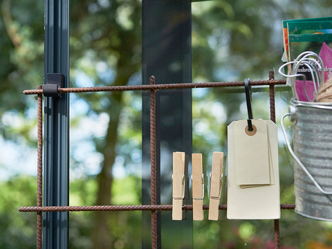 Metal frame for gardening tools hanging on the Juliana Greenhouse Frame Hooks
