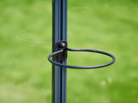 Image of Black Juliana Greenhouse Plant Pot & Tool Holder installed in a greenhouse frame