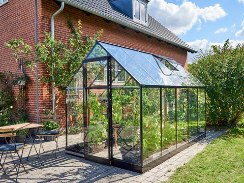 "Frontal view of the Juliana ""The Qube"" Greenhouse 7ft x 11ft with closed sliding door"