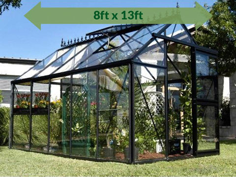 Janssens Junior Victorian J-VIC 24 Greenhouse 8ft x 13ft - full view - in a garden - a green arrow on top showing dimensions