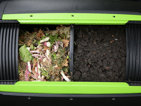Kitchen scraps in one side and mature compost on the other side of the MAZE Two-Stage Compost Tumbler