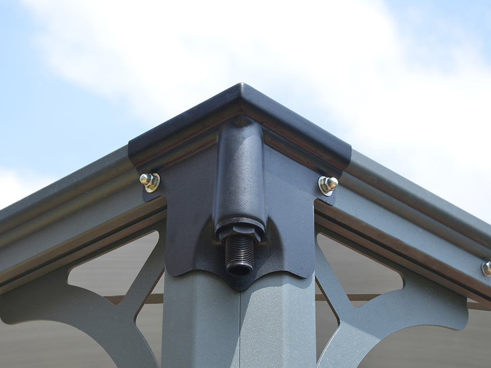 Corner view of Martinique Hard Top Gazebo with a downspout