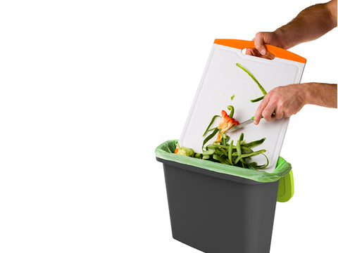 Image of Kitchen scraps moved from a shopping board into the 2.4 gal Maze kitchen bin