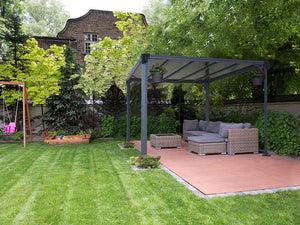 Milano 3000 10ft x 10ft Hard Top Gazebo with a living room set up in a garden