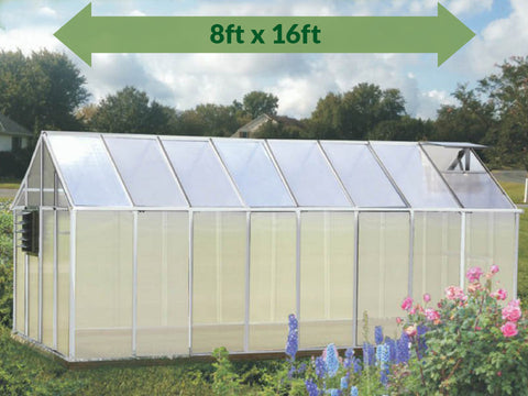 Monticello Growers Edition Greenhouse - full view - arrow on top showing dimensions - in a garden