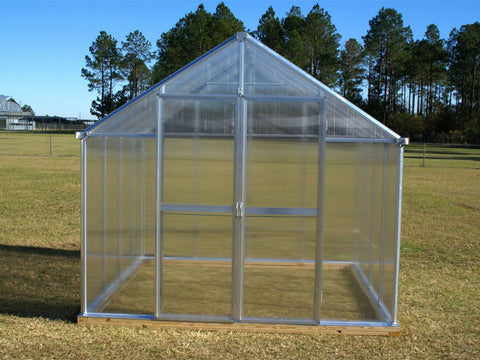 Image of Bare Monticello 8x8 - Life Cycle Package installed in an open ground showing its front view with closed door