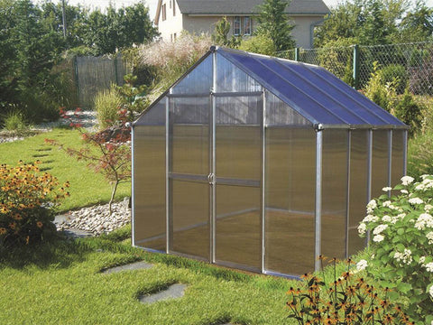 Image of Installed Aluminum Monticello Life Cycle Greenhouse Kit in a garden