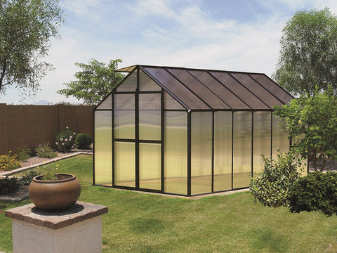Image of Riverstone Monticello Greenhouse 8x12 with black frame in a garden