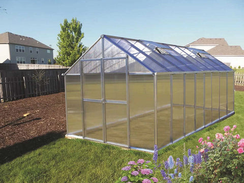 Riverstone Monticello Greenhouse 8x16 - Mojave Package with a silver frame in a garden