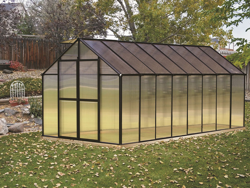 Riverstone Monticello Greenhouse 8x16 - Premium Package with black frame in a garden