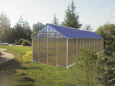 Riverstone Monticello Greenhouse 8x24 with silver frame in a garden