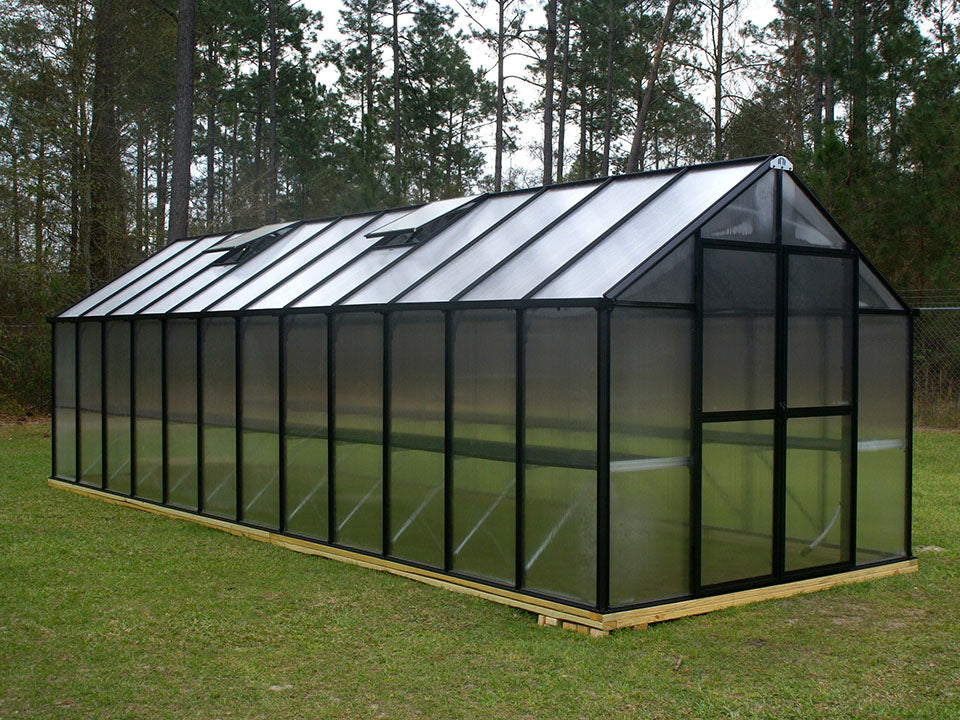 Black Riverstone Monticello Greenhouse 8x24 - Premium Package in a garden