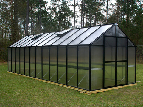 Riverstone Monticello Greenhouse 8x24 with black frame in a garden