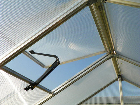 Inside view of the roof vent with automatic opener on a Monticello Greenhouse Growers Package