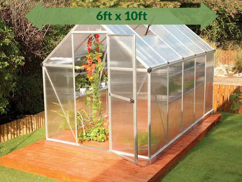 Image of Palram Mythos 6ft x 10ft Hobby Greenhouse HG5010 - full view - green arrow on top with dimensions - in a garden