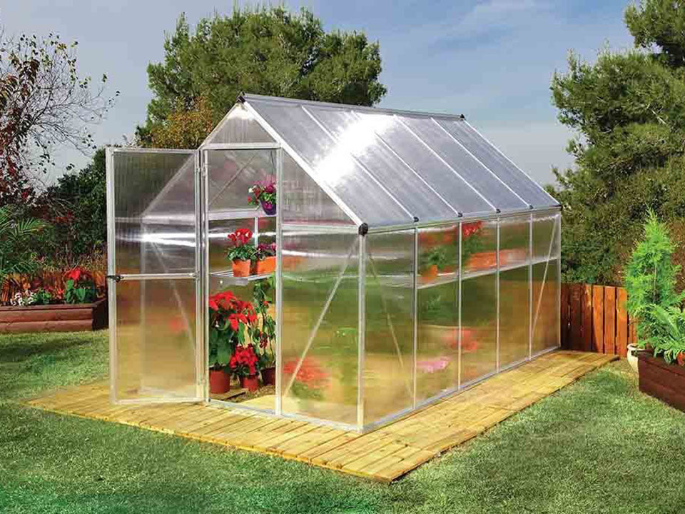 Palram Mythos 6ft x 10ft Hobby Greenhouse HG5010 - front and side view - in a garden