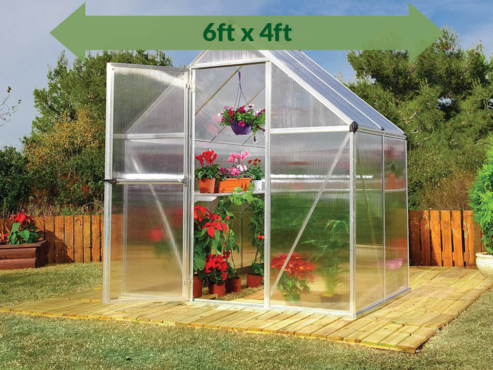 Palram Mythos 6ft x 4ft Hobby Greenhouse HG5005 - full view - green arrow on top with dimensions - in a garden