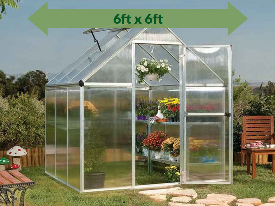 Palram Mythos 6ft x 6ft Hobby Greenhouse HG5006 - full view - green arrow on top with dimensions - in a garden