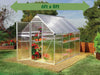 Image of Palram Mythos 6ft x 8ft Hobby Greenhouse HG5008 - full view - green arrow on top with dimensions - in a garden